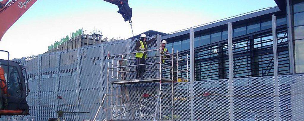 construction workers building blast screen